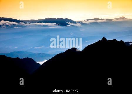 Beautiful view from Fansipan mountain at sunset. Sa Pa, Lao Cai Province, Vietnam. - Stock Photo