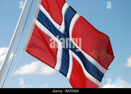A Norwegian flag floating in the wind - Stock Photo