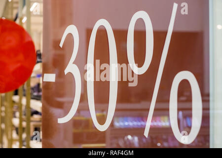 Large Sale 30 off letters on shopping mall wall pillar, bokeh shopping mall.Shopping Mall promotion 50 percent sales shop window.Discount concept . winter,mid season sale. - Stock Photo