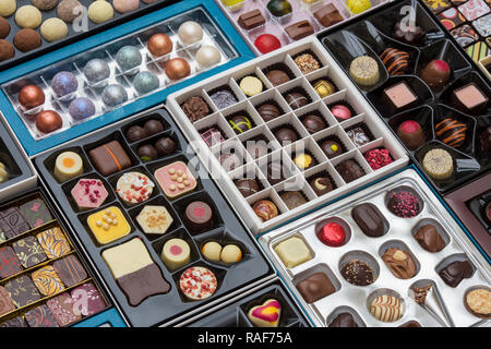 Handmade luxury artisian speciality chocolates in boxes pattern - Stock Photo