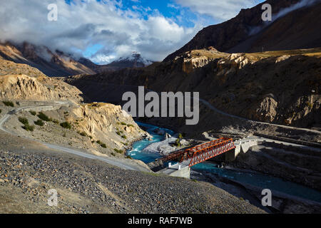 Bridge over Spiti river in Himalayas on sunset - Stock Photo