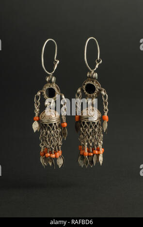 ancient antique earrings with stones on black background  Middle