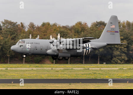 EINDHOVEN, THE NETHERLANDS - JUN 22, 2018: US Air Force Lockheed C-130H Hercules transport plane with D-Day invasion stripes landing on EIndhoven airb - Stock Photo