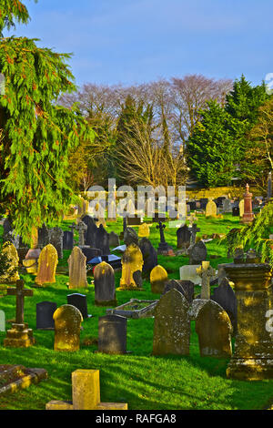 The graveyard of St Mary's Church Coity bathed in the warm glow of Winter sunshine in the late afternoon. Near Bridgend,S.Wales - Stock Photo