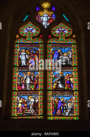 Sarlat, France - September 2, 2018: Colorful Stained Glass in medieval Sarlat Cathedral  dedicated to Saint Sacerdos. Sarlat la Caneda in Dordogne Dep