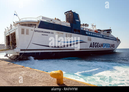 SERIFOS, GREECE - September 20, 2018: Speed Runner III ferry boat arrived at port of Livadi town in Serifos, Greece. - Stock Photo