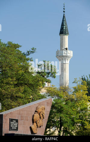 Monument to Soviet marines who died in Yevpatoria assault during WWII and Juma-Jami Mosque (Friday Mosque) built 1552 to 1564 designed by the Ottoman  - Stock Photo