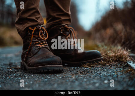 Hiking Boots Standing on Gravel Path in Mountains Wilderness - Stock Photo