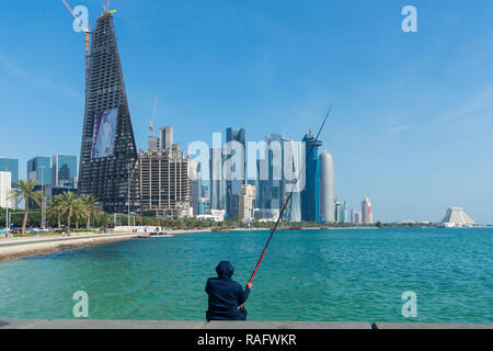 Daytime Skyline view of West Bay business district from The Corniche in Doha, Qatar - Stock Photo