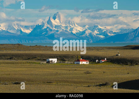 Mount Fitz Roy rises over a ranch in Patagonia in Argentina. - Stock Photo