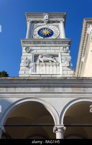 Clock tower in Libertà square in Udine, Italy - Stock Photo