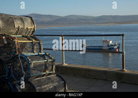 Boat and fishing cages on the harbour at Aberdovey (Aberdyfi) in Gwynedd,Wales,UK - Stock Photo
