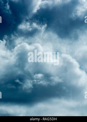 Stylised brooding and dark cloud formations (CT digitally altered to produce green blue effect). Metaphor economic storm clouds, clouds on the horizon - Stock Photo