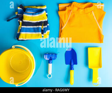 Boy Swiming suit and beach accesories flat lay for Summer vacation theme - Stock Photo
