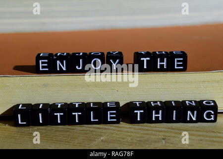Enjoy the little thing on wooden blocks. Motivation and inspiration concept. Cross processed image - Stock Photo