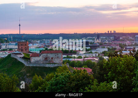 Vilnius, Lithuania - May 15, 2013: Cityscape skyline view on famous Gediminas castle complex and tv tower on the background from Three Crosses Hill pa - Stock Photo