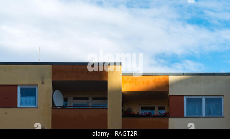 The sun shines on the facade of a residential building - Stock Photo