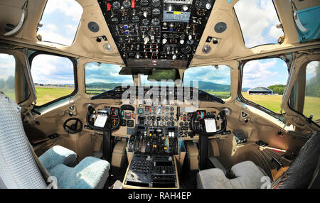 Vintage passenger jet aircraft cockpit interior, pilot's instrument panel - Stock Photo