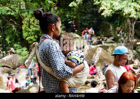 indonesian mother holding her child