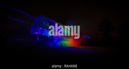 Futuristic abstract rainbow glowing colorful photon tunnel made from DMX lights - Stock Photo
