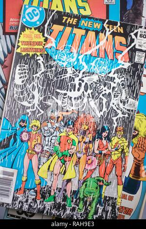 A collection of Teen Titans superhero comic books produced by DC Comics - Stock Photo