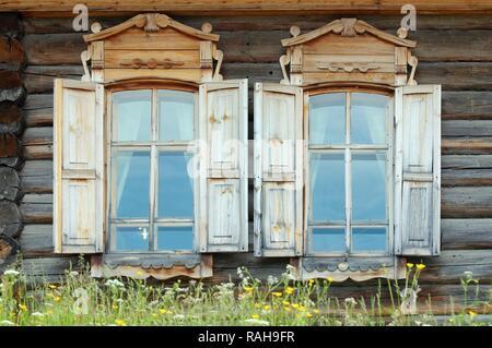 Windows, wooden country estate, settlement of Talzy, Irkutsk region, Baikal, Siberia, Russian Federation, Eurasia - Stock Photo