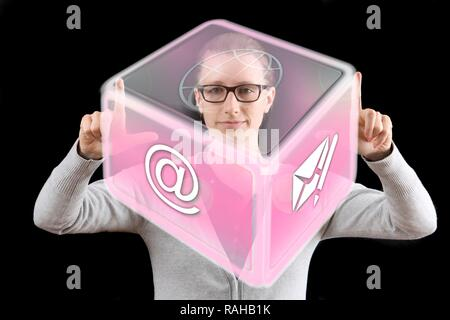 Woman using a virtual icon, interactive user interface, symbolic image for virtual work - Stock Photo