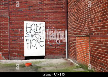 Graffiti, Home Sweet Home, on the door of a building to be demolished, old factory hall, Herten, North Rhine-Westphalia - Stock Photo
