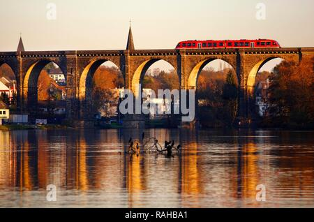 Regional railway, Regio-Bahn, on a railway viaduct over the Ruhr river, Harkortsee reservoir near Herdecke - Stock Photo