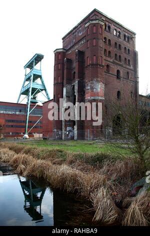 Zeche Ewald Colliery, former coal mine, Doppelbock headframe of mine shaft No. 7, left, and Malakow Tower, Herten - Stock Photo