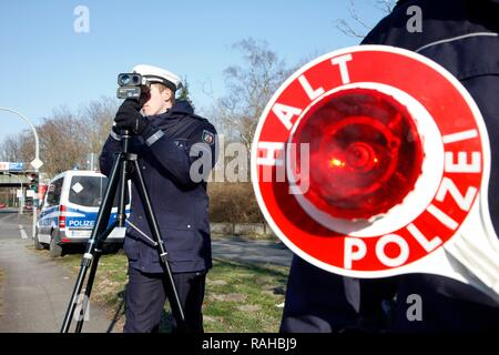 Laser measuring device being used by the police, speed trap marathon of the police in North Rhine-Westphalia, 24 hours of - Stock Photo