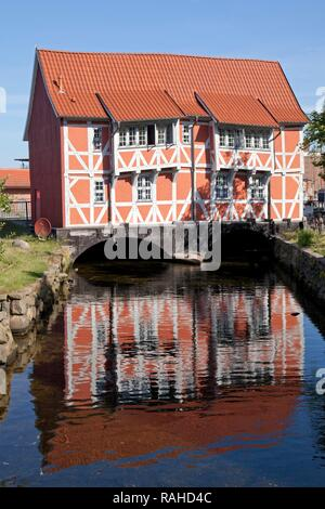 Half-timbered building 'Gewoelbe' above the regulated 'Grube' creek, Wismar, Mecklenburg-Western Pomerania - Stock Photo