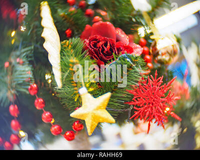 Bright and beautifully decorated with toys Christmas tree against shiny illuminated soft focused background. Christmas and New Year concept. - Stock Photo