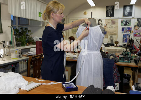 St. Petersburg, Russia - October 26, 2016: Unidentified apparel cutter at work in the Alexandrinsky theater. The theater was created in 1756 by the or - Stock Photo