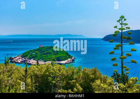 Scenic view at little island Host in front of Vis town, Croatia. - Stock Photo