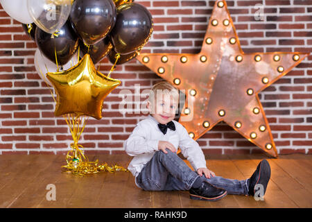 Beautiful kids, little boys celebrating birthday and blowing candles on homemade baked cake, indoor Birthday party for siblings children. Happy twins  - Stock Photo