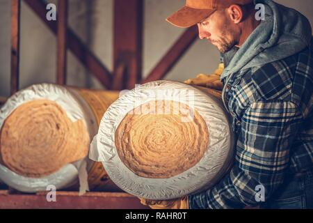 Insulating Material Buying. Mineral Rock Wool Rolls. - Stock Photo