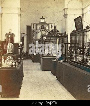 Display cabinets with objects in the exhibition of National Industry and Art in the Palace of Industry, Amsterdam reimagined - Stock Photo