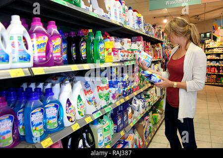 Shelf with cleaning products, washing powders, supermarket