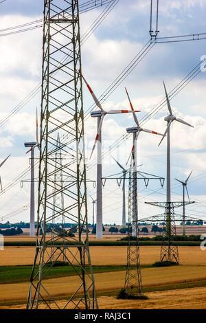 Wind turbines, wind power plant, wind farm, high voltage power lines, at Meerhof, North Rhine-Westphalia - Stock Photo