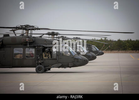 New Jersey Army National Guard UH-60L Black Hawk helicopters from Det. 2, Charlie Company, 1-171st General Support Aviation Battalion (MEDEVAC) prepare to take off for a deployment in support of Operation Freedom's Sentinel in Afghanistan on Joint Base McGuire-Dix-Lakehurst, N.J., Jan. 3, 2019. (U.S. Air National Guard photo by Master Sgt. Matt Hecht) - Stock Photo