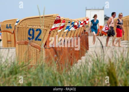 Roofed wicker beach chairs, Timmendorf, Poel island, Mecklenburg-Western Pomerania - Stock Photo