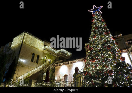 Christmas decorations of the American Colony Hotel complex located in a historic building which previously housed the utopian American-Swedish community known as the American Colony in East Jerusalem Israel - Stock Photo