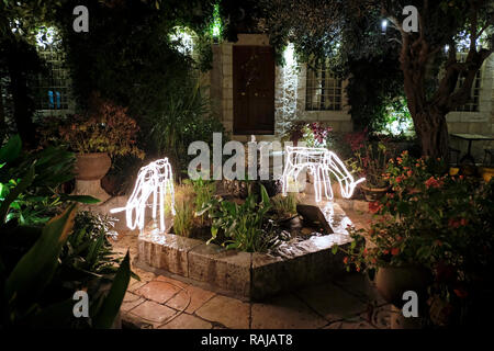 Christmas decorations at the inner courtyard of the American Colony Hotel located in a historic building which previously housed the utopian American-Swedish community known as the American Colony in East Jerusalem Israel - Stock Photo