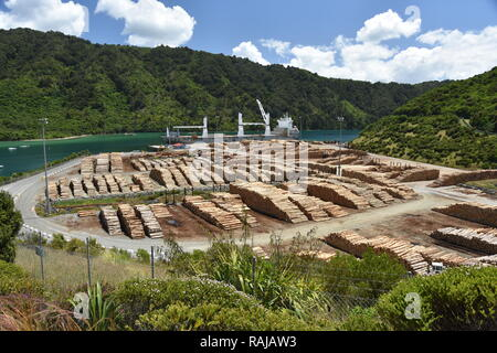 At the Waimahara Wharf in Shakespeare Bay, top of the South Island, the Chipol Huanghe awaits loading of logs for export - Stock Photo
