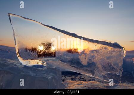 Car seen through a piece of ice, Olkhon island, Lake Baikal, Siberia, Russia, Eurasia - Stock Photo