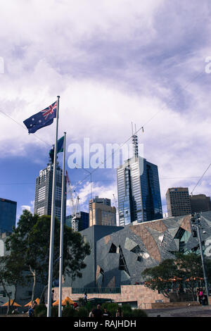 The flag of Australia flying on Federation square in Melbourne, Australia - Stock Photo