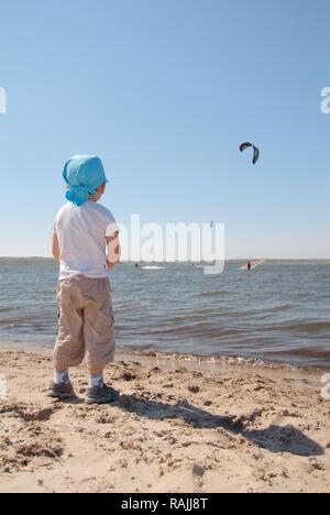 Little boy, kite surfing, Black Sea, Odessa, Ukraine, Eastern Europe - Stock Photo