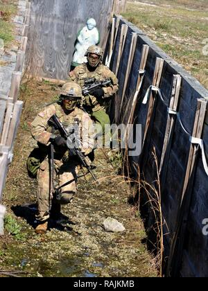 Soldiers from 1st Battalion, 64th Armor Regiment clear a trench during a company Combined Arms Live-Fire Exercise at Fort Stewart, Georgia Feb. 7, 2017. - Stock Photo