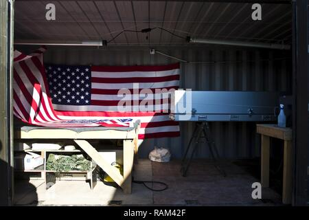 This is a container that includes a steamer and iron for removing wrinkles in flags, a rope system that can drape flags over top a transfer cases (casket) and a transfer case owned and operated by the 246th Quartermaster Company (Mortuary Affairs), in Erbil, Iraq on February 3, 2017. - Stock Photo